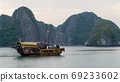 Cat Ba, Vietnam - November 19, 2019 : Junk boat cruising in Lan Ha Bay 69233602