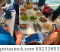 El Nido, Philippines - October 19, 2019 : Lunch being served on island tour boat. 69233603