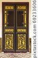 Penang, Malaysia - September 21, 2019 : Gold and Black door on old Chinese Shophouse. 69233606