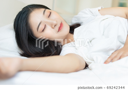Woman on bed 69242344