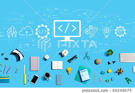 Web development concept with electronic gadgets and office supplies 69248674