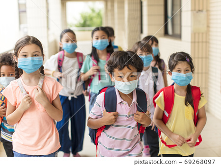 children wearing  face medical mask back to school after covid-19 quarantine 69268097