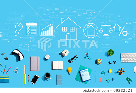 Real estate theme with electronic gadgets and office supplies 69282321