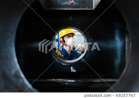 Expert checking the quality of manufactured boilers 69287767