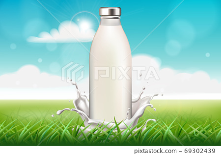 Bottle of milk surrounded by splashes on grass background. Blue sky 69302439