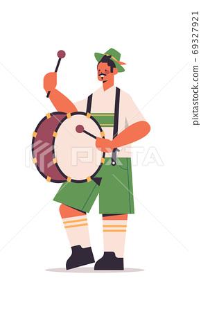 musician playing drum on biggest folk festival Oktoberfest party concept 69327921