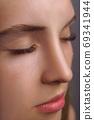 Eyelash Extension Procedure. Woman Eye with Long Eyelashes. Close up, selective focus. 69341944