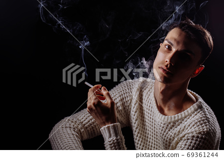 Pencice handsome man with cigarette 69361244