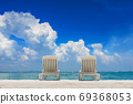 Couple of beach beds on tropical beach with beautyful blue sky 69368053