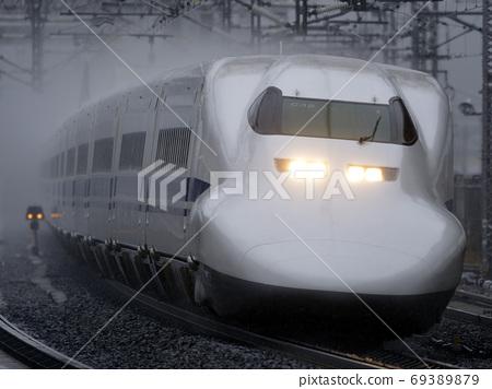 Tokaido Shinkansen 700 series C32 formation running in the rain 69389879