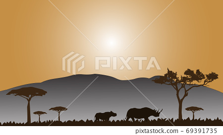 Full frame silhouette family of rhinoceros in the grassland on the multicolor background. 69391735