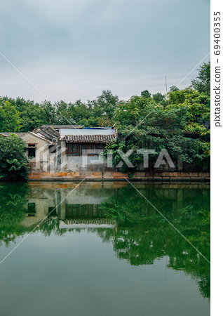 Tongzi River and old houses with green trees in Beijing, China 69400355