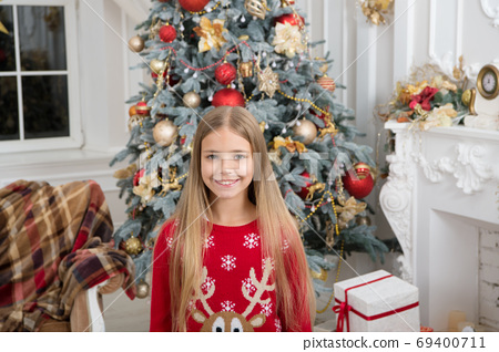 Child enjoy the holiday. Christmas tree and presents.  69400711