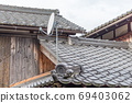 Satellite dish on old traditional houses. Kumagawa, a small village on the historic trading route from Kyoto to Fukui, Japan. 69403062