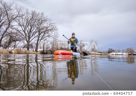 solo lake paddling as social distancing recreation 69404757