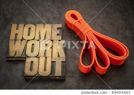 home workout and fitness concept with resistance band 69404865