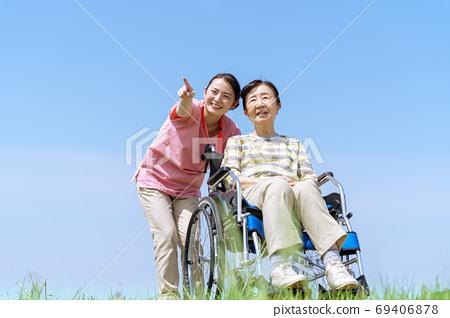 Senior women, long-term care, wheelchairs, blue sky 69406878