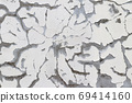 Old cracked and eroded plaster 69414160