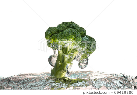 Green broccoli falling in water with splash on white with air bubbles 69419280