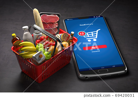 Shopping basket with fresh food and smartphone or mobile. Grocer 69420031