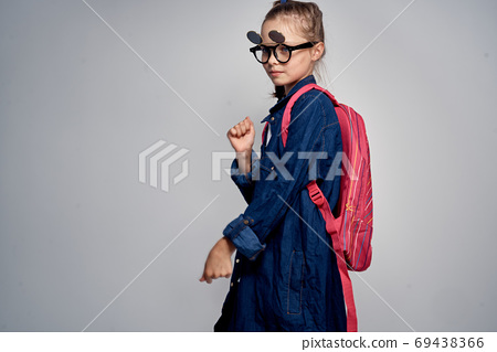 school girl with pink backpack swoosh pigtail fun learning light background school childhood 69438366