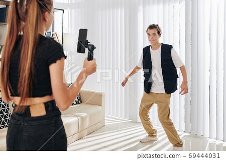 Teenagers filming dance video 69444031