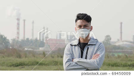 asian man wears protective mask 69450009
