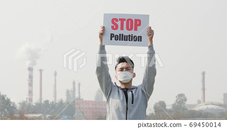 man hold stop pollution sign 69450014