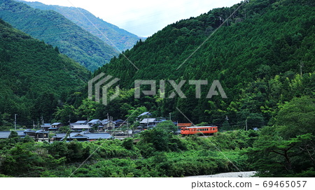 Train running in the country 69465057