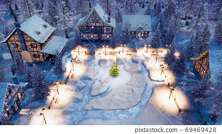 Snowbound village at Christmas night aerial view 69469428