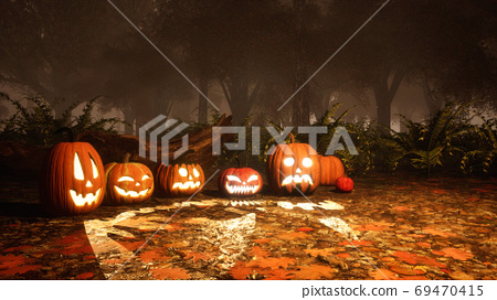 Halloween pumpkins in scary autumn forest at dusk 69470415