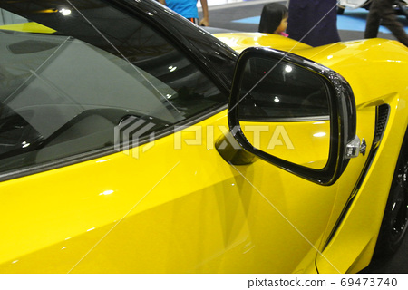 KUALA LUMPUR, MALAYSIA -NOVEMBER 12, 2017: Car side mirror or door mirror build at extrior of car for the purposes of helping the driver see areas behind and to the sides of the vehicle.   69473740
