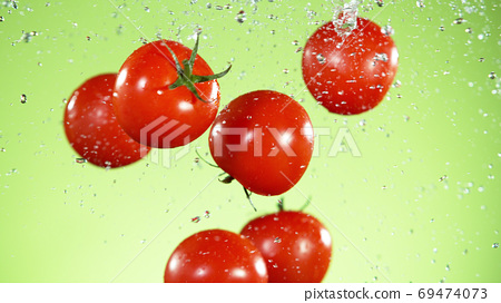 Freeze motion of tomatoes in the air 69474073