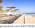 Sunny beach with wonderful sand coast and view on the sea. 69474696