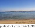 Tropical beach on a sunny day photo. Blue sea with a sandy beach. 69474699