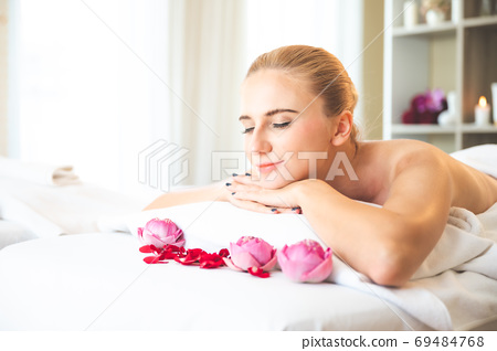Health care and thai massage. Beautiful woman smile and relax in spa salon 69484768