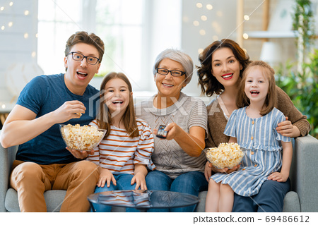Happy family spending time together. 69486612