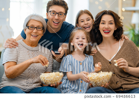Happy family spending time together. 69486613