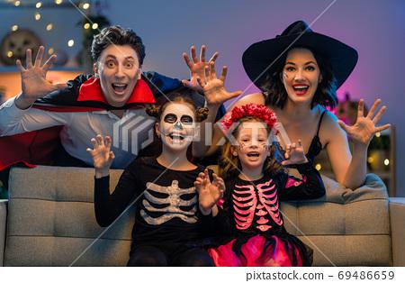 Happy family celebrating Halloween 69486659