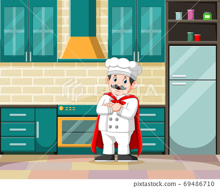The master of cooking with his white costume in the kitchen 69486710
