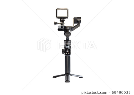 Action camera is mounted on a 3-axis motor stabilizer. 69490033