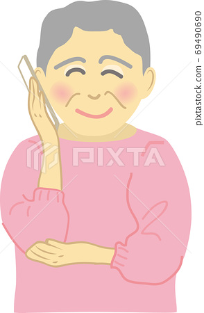 Senior woman talking on smartphone with a smile 69490690