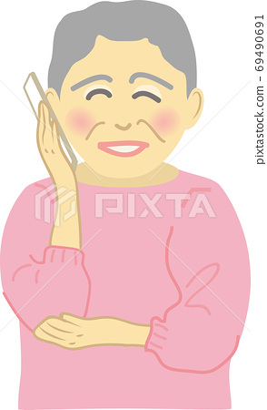 Senior woman talking on smartphone with a smile 69490691