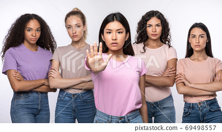 Asian Woman Gesturing Stop Protecting Group Of Ladies, Studio Shot 69498557