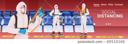professional cleaners in hazmat suits cleaning and disinfecting coronavirus cells cinema hall interior 69510106