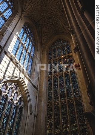 stained glass window in a church in the city of Bath in the united kingdom 69511264