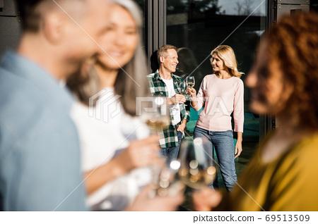 Loving couple standing near the panoramic window outdoors 69513509
