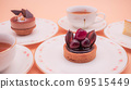 Tea party with lots of sweets such as cakes and tarts 69515449