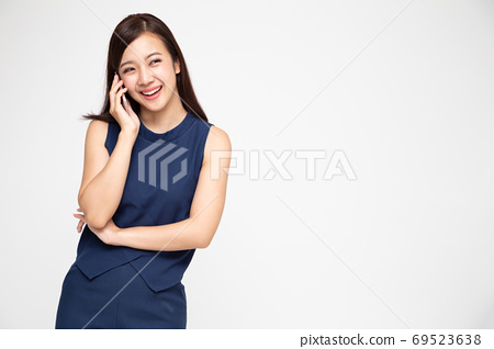 Asian woman smiling while talking on the phone. 69523638