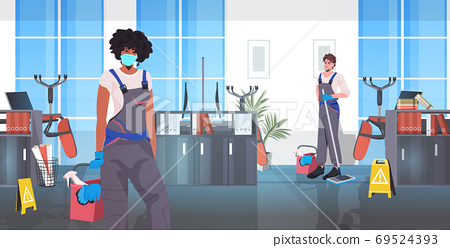 professional cleaners team mix race janitors with cleaning equipment working together 69524393